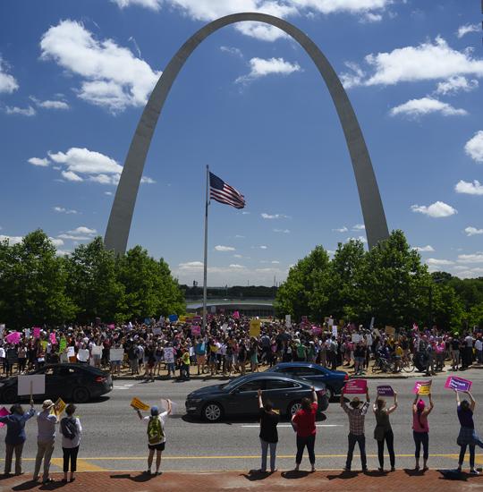Activists near St. Louis Arch.