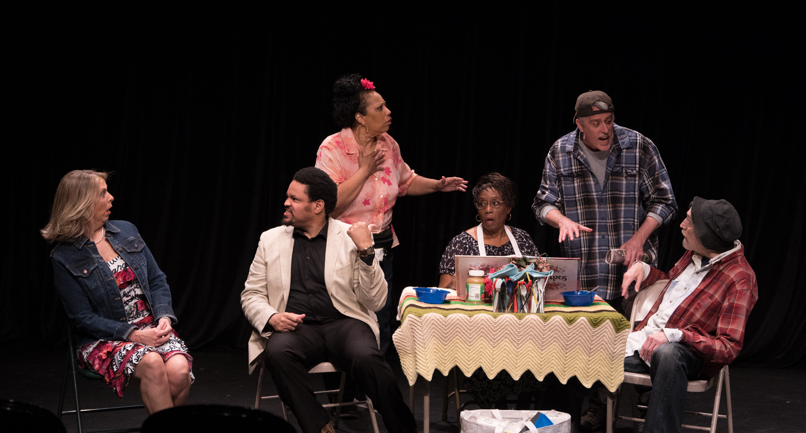 Six people in a stage production