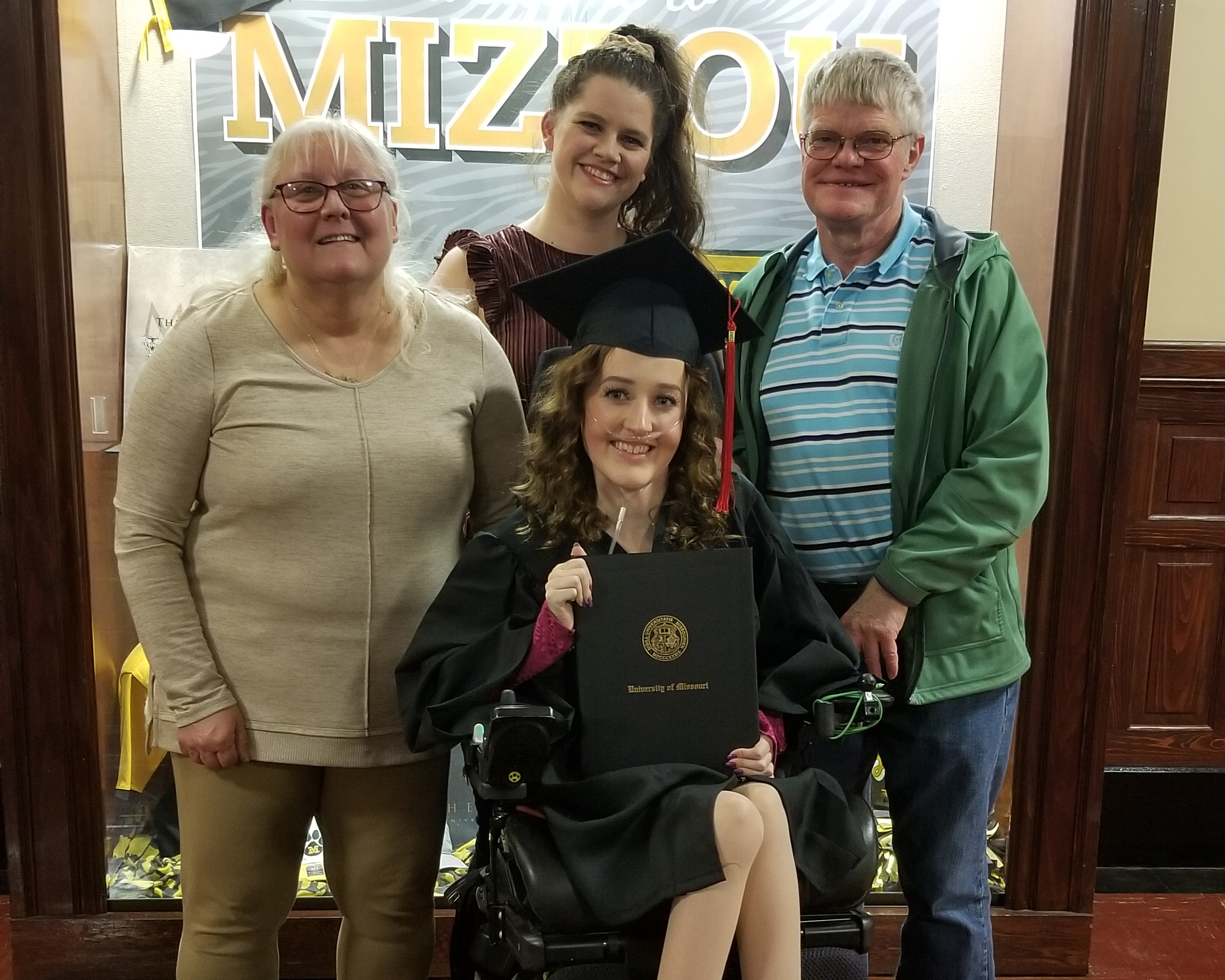 Madi Lawson with the Smith family at her December graduation from the University of Missouri School of Journalism.